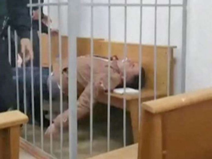 Belarusian prisoner tries to cut own throat in court hearing